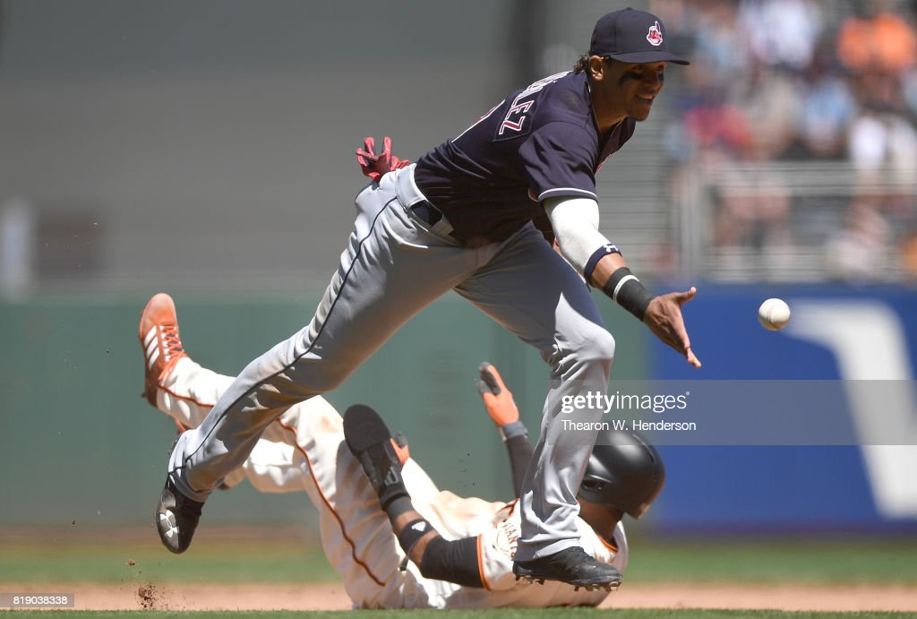 Erik Gonzalez #9 of the Cleveland Indians underhands the ball to first base to complete a double-play after tagging out Eduardo Nunez #10 of the San Francisco Giants and in the bottom of the seventh inning at AT&T Park on July 19, 2017 in San Francisco, California.