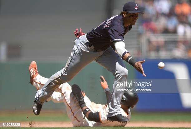 Erik Gonzalez of the Cleveland Indians underhands the ball to first base to complete a doubleplay after tagging out Eduardo Nunez of the San...