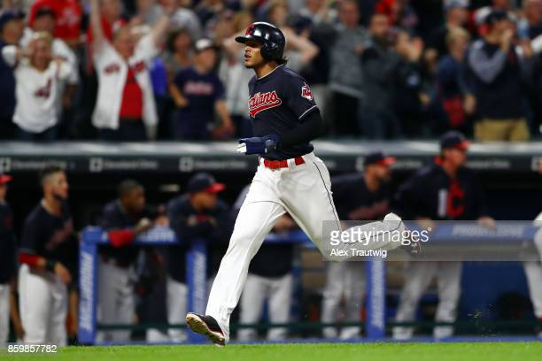 Erik Gonzalez scores on a double by Francisco Lindor of the Cleveland Indians in the bottom of the ninth inning during the game against the Kansas...