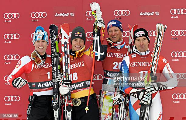 Erik Guay of Canada takes 1st place Hannes Reichelt of Austria takes the place Aksel Lund Svindal of Norway takes 3rd place and Tobias Gruenenfelder...