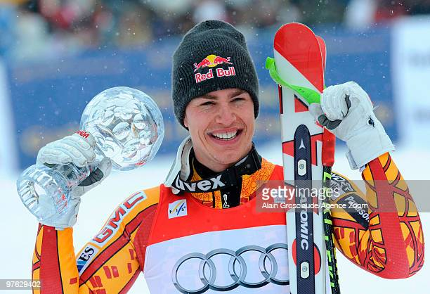 Erik Guay of Canada takes the globe for the overall World Cup Super G during the Audi FIS Alpine Ski World Cup Men's Super G on March 11 2010 in...