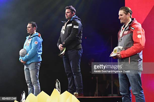 Erik Guay of Canada wins the silver medal Beat Feuz of Switzerland wins the gold medal Max Franz of Austria wins the bronze medal during the FIS...
