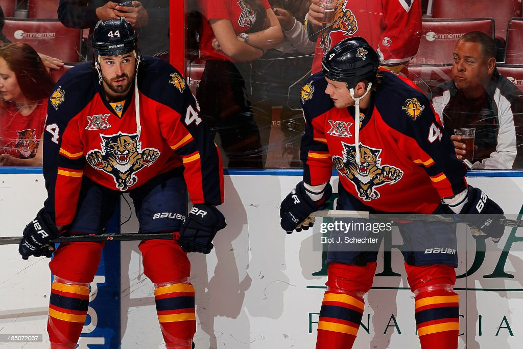 Erik Gudbranson #44 and Dylan Olsen #4 of the Florida Panthers chat on the ice prior to the start of the game against the Columbus Blue Jackets at the BB&T Center on April 12, 2014 in Sunrise, Florida.