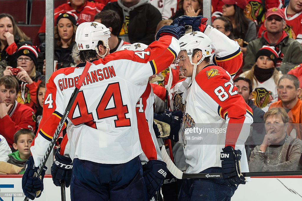 Erik Gudbranson #44 and Tomas Kopecky #82 of the Florida Panthers celebrate with teammates after the Panthers scored against the Chicago Blackhawks in the second period during the NHL game on December 08, 2013 at the United Center in Chicago, Illinois.
