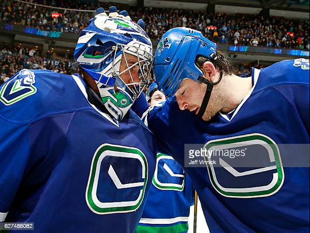 Erik Gudbranson congratulates Ryan Miller of the Vancouver Canucks after defeating the Toronto Maple Leafs during their NHL game at Rogers Arena...