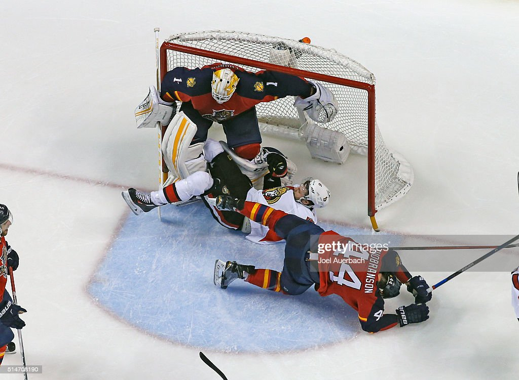 Erik Gudbranson #44 of the Florida Panthers and Bobby Ryan #6 of the Ottawa Senators run into Goaltender Roberto Luongo #1 during third period action at the BB&T Center on March 10, 2016 in Sunrise, Florida. The Panthers defeated the Senators 6-2.