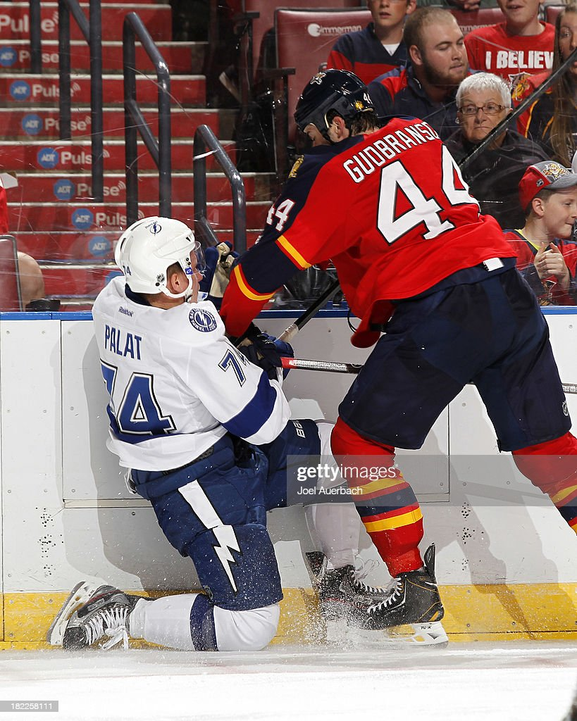 <a gi-track='captionPersonalityLinkClicked' href=/galleries/search?phrase=Erik+Gudbranson&family=editorial&specificpeople=5741800 ng-click='$event.stopPropagation()'>Erik Gudbranson</a> #44 of the Florida Panthers checks Ondrej Palat #74 of the Tampa Bay Lightning during second period action at the BB&T Center on September 28, 2013 in Sunrise, Florida.
