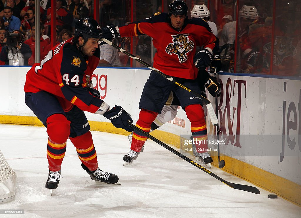 Erik Gudbranson #44 of the Florida Panthers digs the puck out from the boards against the Pittsburgh Penguins at the BB&T Center on April 13, 2013 in Sunrise, Florida.
