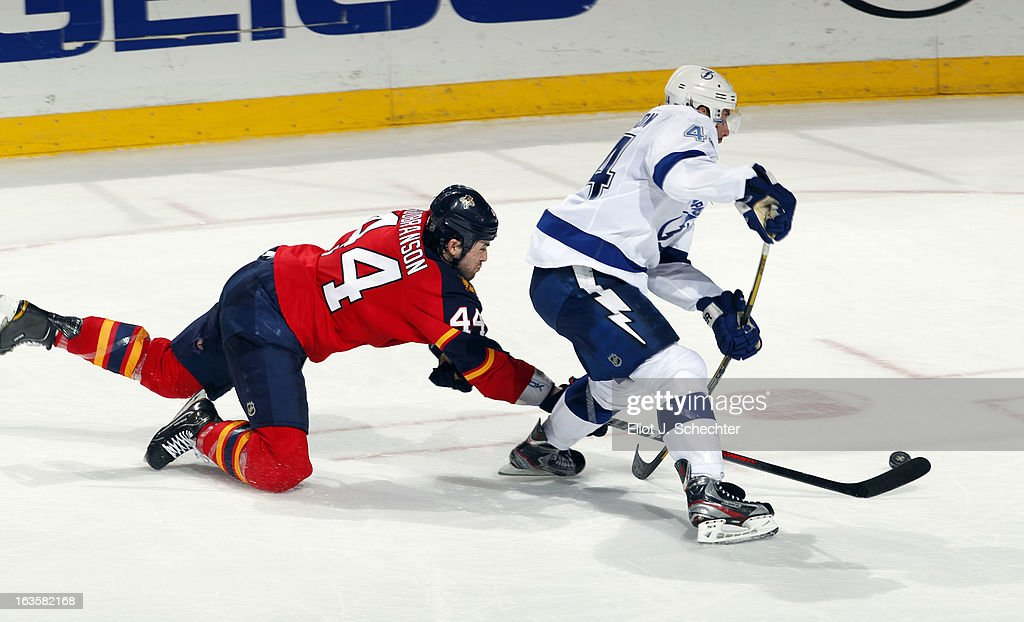 <a gi-track='captionPersonalityLinkClicked' href=/galleries/search?phrase=Erik+Gudbranson&family=editorial&specificpeople=5741800 ng-click='$event.stopPropagation()'>Erik Gudbranson</a> #44 of the Florida Panthers dives for the puck against Nate Thompson #44 of the Tampa Bay Lightning at the BB&T Center on March 12, 2013 in Sunrise, Florida.