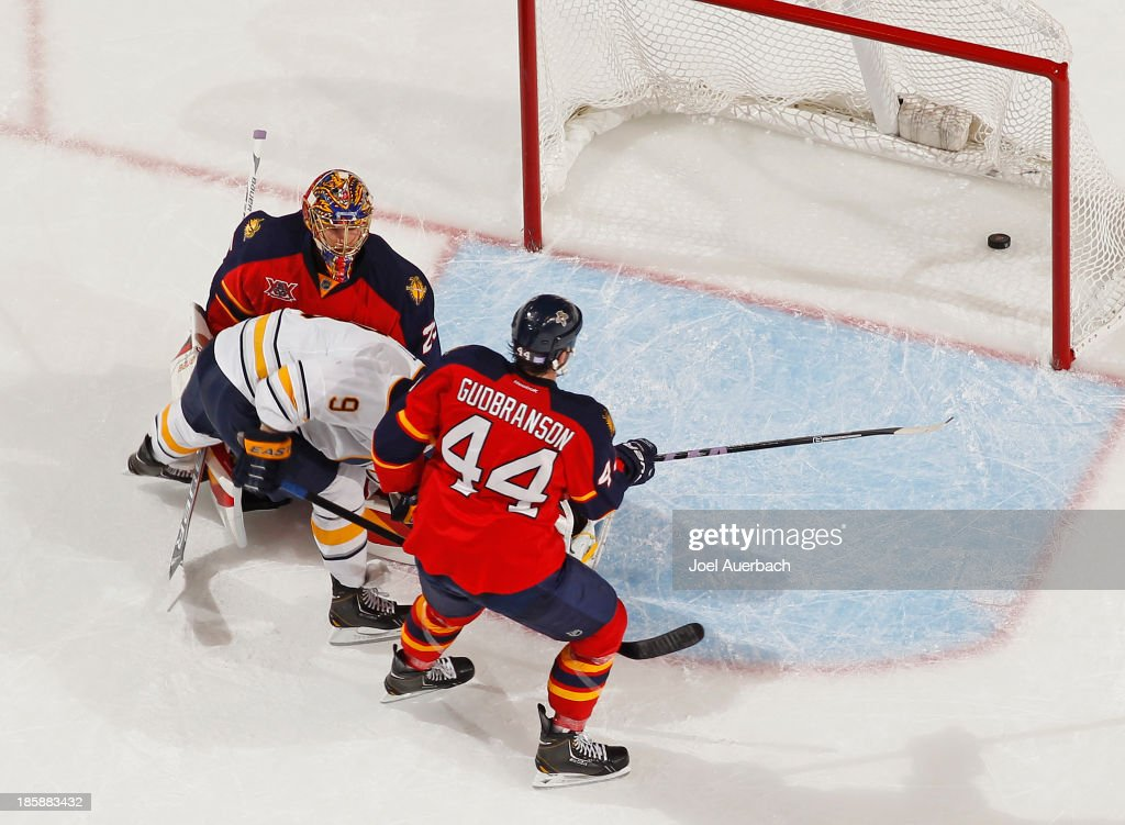 <a gi-track='captionPersonalityLinkClicked' href=/galleries/search?phrase=Erik+Gudbranson&family=editorial&specificpeople=5741800 ng-click='$event.stopPropagation()'>Erik Gudbranson</a> #44 of the Florida Panthers looks on as <a gi-track='captionPersonalityLinkClicked' href=/galleries/search?phrase=Steve+Ott&family=editorial&specificpeople=210616 ng-click='$event.stopPropagation()'>Steve Ott</a> #9 of the Buffalo Sabres scores a goal past goaltender <a gi-track='captionPersonalityLinkClicked' href=/galleries/search?phrase=Jacob+Markstrom&family=editorial&specificpeople=5370948 ng-click='$event.stopPropagation()'>Jacob Markstrom</a> #25 during third period action at the BB&T Center on October 25, 2013 in Sunrise, Florida. The Sabres defeated the Panthers 3-1.