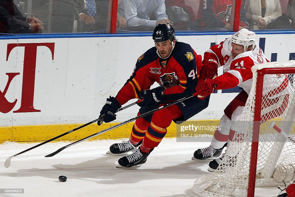<a gi-track='captionPersonalityLinkClicked' href=/galleries/search?phrase=Erik+Gudbranson&family=editorial&specificpeople=5741800 ng-click='$event.stopPropagation()'>Erik Gudbranson</a> #44 of the Florida Panthers skates with the puck against against <a gi-track='captionPersonalityLinkClicked' href=/galleries/search?phrase=Daniel+Alfredsson&family=editorial&specificpeople=201853 ng-click='$event.stopPropagation()'>Daniel Alfredsson</a> #11 of the Detroit Red Wings at the BB&T Center on December 10, 2013 in Sunrise, Florida.