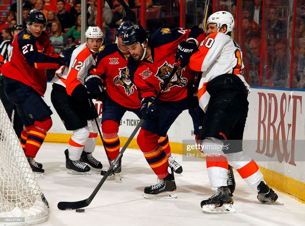 Erik Gudbranson #44 of the Florida Panthers tangles with Brayden Schenn #10 of the Philadelphia Flyers at the BB&T Center on April 8, 2014 in Sunrise, Florida.