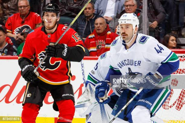 Erik Gudbranson of the Vancouver Canucks and Matthew Tkachuk of the Calgary Flames in an NHL game against the Vancouver Canucks at the Scotiabank...