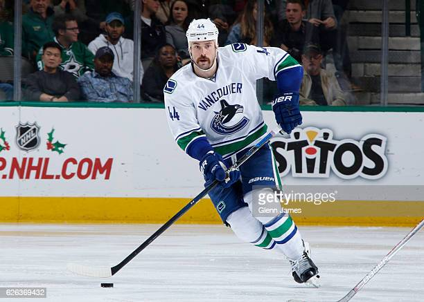 Erik Gudbranson of the Vancouver Canucks handles the puck against the Dallas Stars at the American Airlines Center on November 25 2016 in Dallas Texas