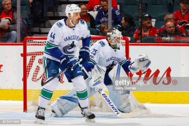Erik Gudbranson of the Vancouver Canucks helps his goalie Jacob Markstrom defend the net in an NHL game against the Calgary Flames at the Scotiabank...