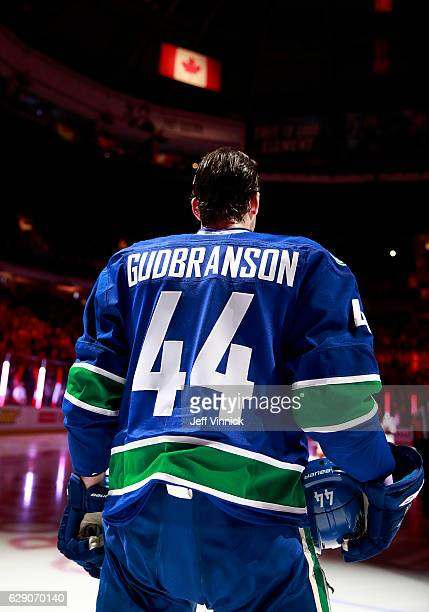 Erik Gudbranson of the Vancouver Canucks listens to the national anthem during their NHL game against the Anaheim Ducks at Rogers Arena December 1...