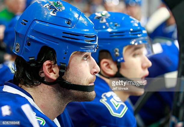 Erik Gudbranson of the Vancouver Canucks looks on from the bench during their NHL game against the Toronto Maple Leafs at Rogers Arena December 3...