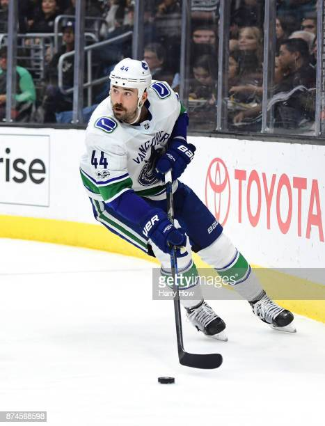 Erik Gudbranson of the Vancouver Canucks looks up as he turns with the puck against the Los Angeles Kings at Staples Center on November 14 2017 in...