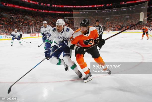 Erik Gudbranson of the Vancouver Canucks skates against Jakub Voracek of the Philadelphia Flyers during the second period at the Wells Fargo Center...