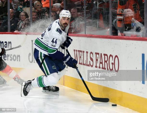 Erik Gudbranson of the Vancouver Canucks skates the puck against the Philadelphia Flyers on November 21 2017 at the Wells Fargo Center in...
