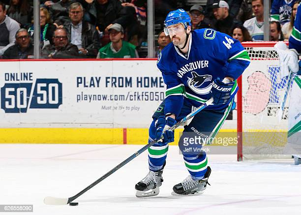 Erik Gudbranson of the Vancouver Canucks skates up ice with the puck during their NHL game against the New York Rangers at Rogers Arena November 15...