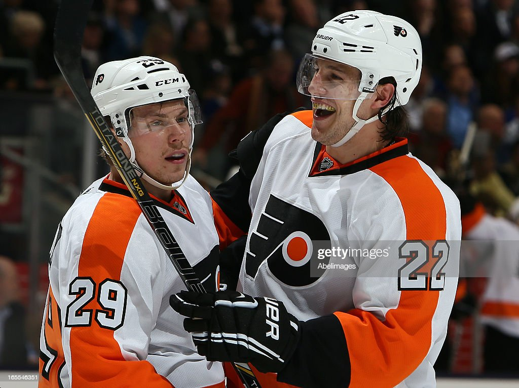Erik Gustafsson #29 and Luke Schenn #22 of the Philadelphia Flyers celebrate late goal against the Toronto Maple Leafs during NHL action at the Air Canada Centre April 4, 2013 in Toronto, Ontario, Canada.