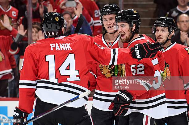 Erik Gustafsson of the Chicago Blackhawks reacts after assisting in the goal of Richard Panik against the Montreal Canadiens in the first period of...
