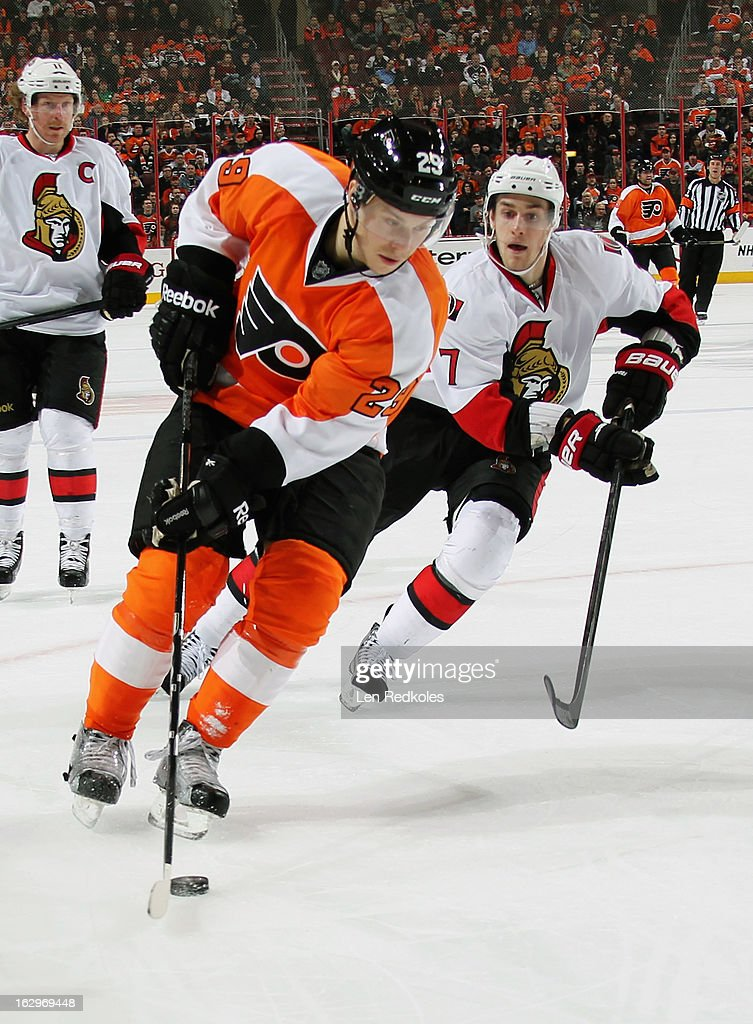 Erik Gustafsson #29 of the Philadelphia Flyers controls the puck in the corner while being pursued by <a gi-track='captionPersonalityLinkClicked' href=/galleries/search?phrase=Kyle+Turris&family=editorial&specificpeople=4251834 ng-click='$event.stopPropagation()'>Kyle Turris</a> #7 of the Ottawa Senators on March 2, 2013 at the Wells Fargo Center in Philadelphia, Pennsylvania. The Flyers went on to defeat the Senators 2-1.