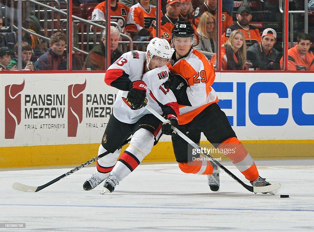 Erik Gustafsson #29 of the Philadelphia Flyers holds off Peter Regin #13 of the Ottawa Senators at the Wells Fargo Center on March 2, 2013 in Philadelphia, Pennsylvania.