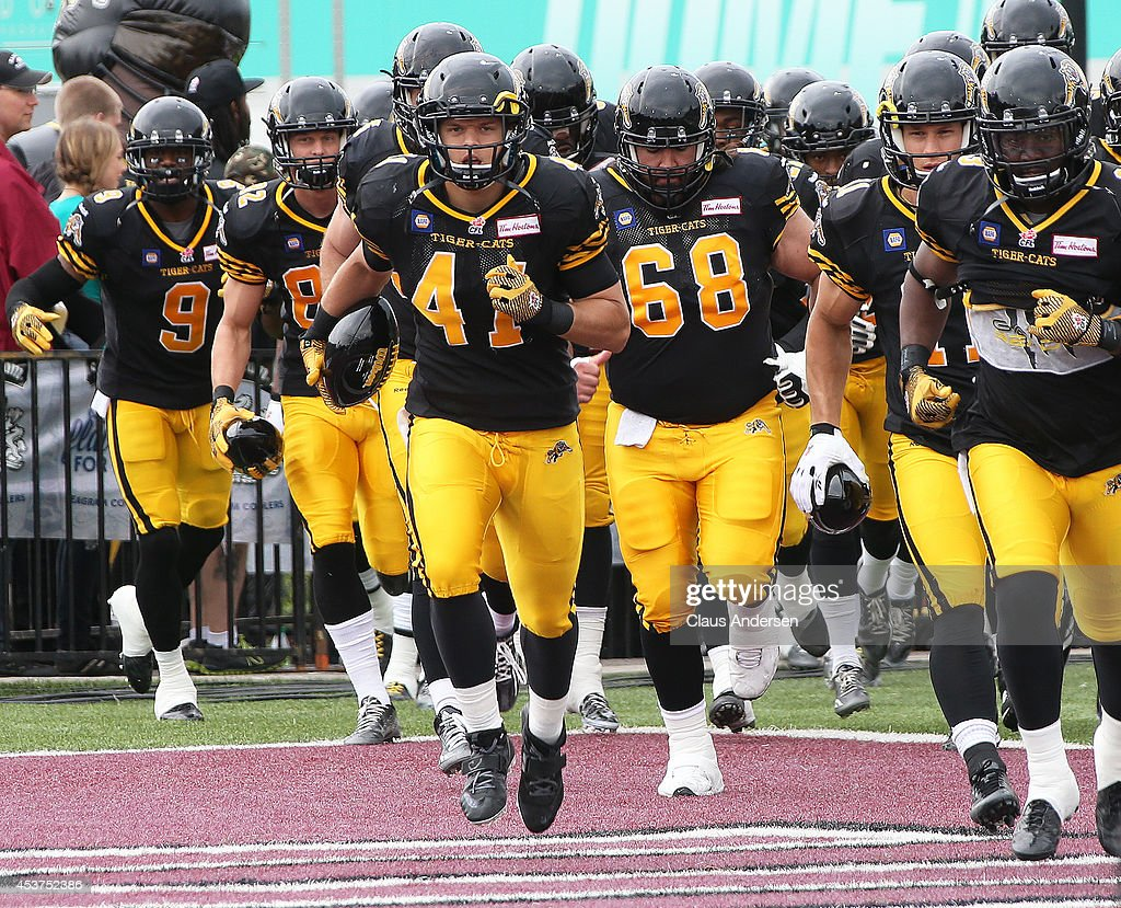 Erik Harris of the Hamilton TigerCats and his teammates get set to play against the Calgary Stampeders in a CFL game at Ron Joyce Stadium on August...