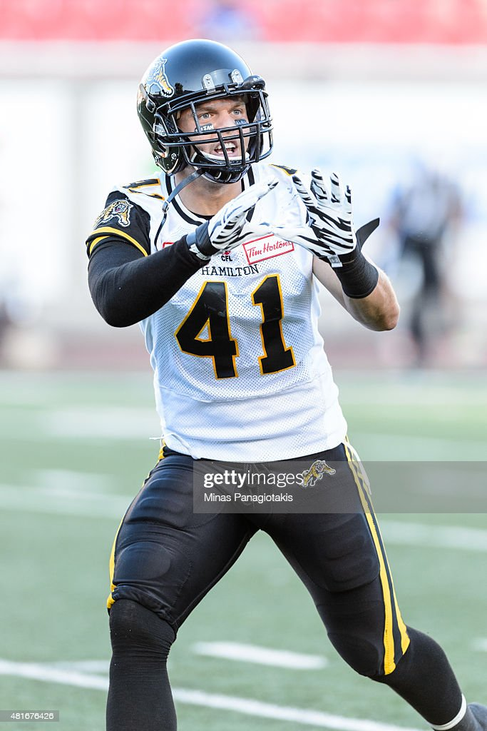 Erik Harris of the Hamilton TigerCats calls for the ball during the warmup prior to the CFL game against the Montreal Alouettes at Percival Molson...