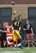 Erik Harris of the Hamilton TigerCats hauls in a touchdown pass against the Calgary Stampeders in a CFL game at Ron Joyce Stadium on August 16 2014...