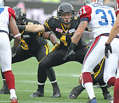 Erik Harris of the Hamilton TigerCats plays against the Montreal Alouettes during the CFL football Eastern Conference Final at Tim Hortons Field on...