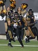 Erik Harris of the Hamilton TigerCats scores a touchdown against the BC Lions during a CFL football game at Tim Hortons Field on August 15 2015 in...