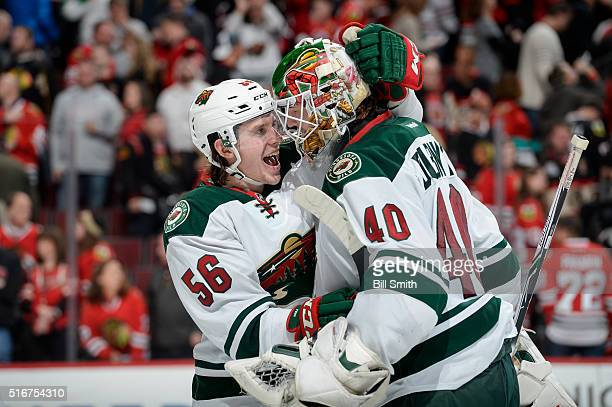 Erik Haula and goalie Devan Dubnyk of the Minnesota Wild celebrate after defeating the Chicago Blackhawks 3 to 2 in a shootout during the NHL game at...