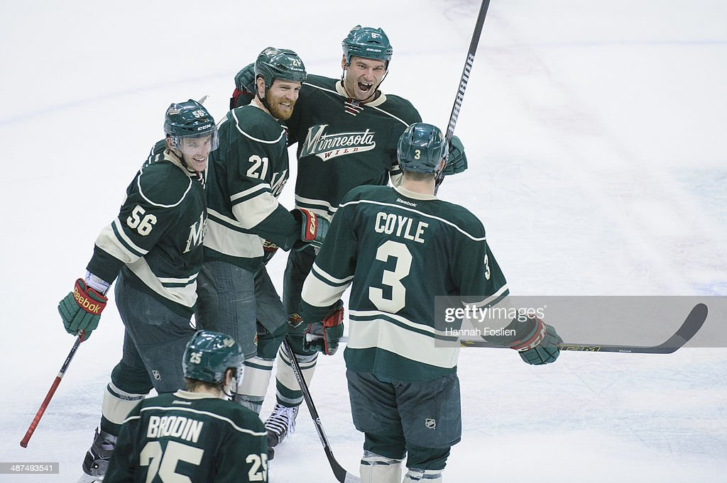 Erik Haula #56, Jonas Brodin #25, Kyle Brodziak #21, Cody McCormick #8 and Charlie Coyle #3 of the Minnesota Wild celebrate a win against the Colorado Avalanche of Game Six of the First Round of the 2014 NHL Stanley Cup Playoffs on April 28, 2014 at Xcel Energy Center in St Paul, Minnesota. The Wild defeated the Avalanche 5-2.
