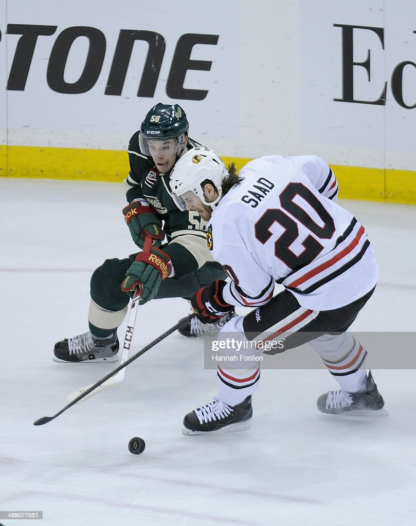 <a gi-track='captionPersonalityLinkClicked' href=/galleries/search?phrase=Erik+Haula&family=editorial&specificpeople=5894652 ng-click='$event.stopPropagation()'>Erik Haula</a> #56 of the Minnesota Wild an d<a gi-track='captionPersonalityLinkClicked' href=/galleries/search?phrase=Brandon+Saad&family=editorial&specificpeople=7128385 ng-click='$event.stopPropagation()'>Brandon Saad</a> #20 of the Chicago Blackhawks skate after the puck during the first period in Game Four of the Second Round of the 2014 NHL Stanley Cup Playoffs on May 9, 2014 at Xcel Energy Center in St Paul, Minnesota. The Wild defeated the Blackhawks 4-2.