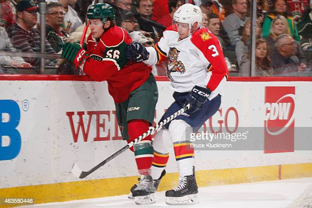 Erik Haula of the Minnesota Wild battles for the puck along the boards with Steven Kampfer of the Florida Panthers during the game on February 12...