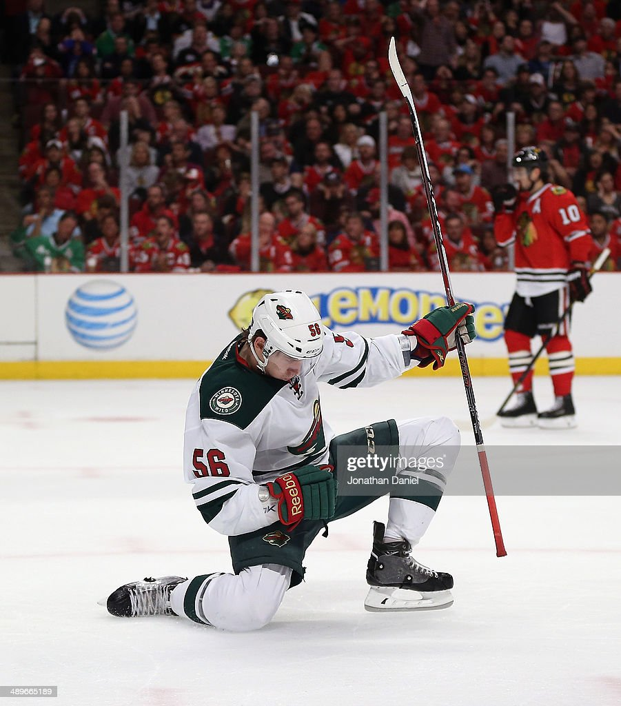 <a gi-track='captionPersonalityLinkClicked' href=/galleries/search?phrase=Erik+Haula&family=editorial&specificpeople=5894652 ng-click='$event.stopPropagation()'>Erik Haula</a> #56 of the Minnesota Wild celebrates his first period goal against the Chicago Blackhawks in Game Five of the Second Round of the 2014 NHL Stanley Cup Playoffs at the United Center on May 11, 2014 in Chicago, Illinois.