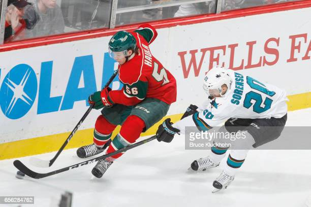 Erik Haula of the Minnesota Wild handles the puck with Marcus Sorensen of the San Jose Sharks defending during the game on March 21 2017 at the Xcel...
