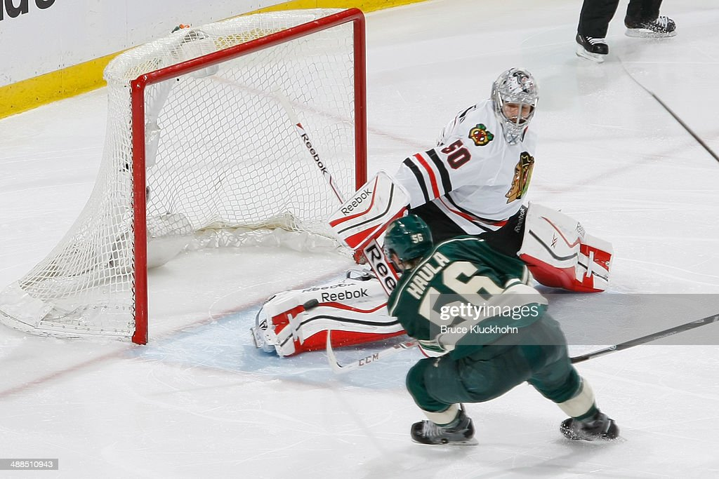 Erik Haula #56 of the Minnesota Wild scores a goal against Corey Crawford #50 of the Chicago Blackhawks during Game Three of the Second Round of the 2014 Stanley Cup Playoffs on May 6, 2014 at the Xcel Energy Center in St. Paul, Minnesota.