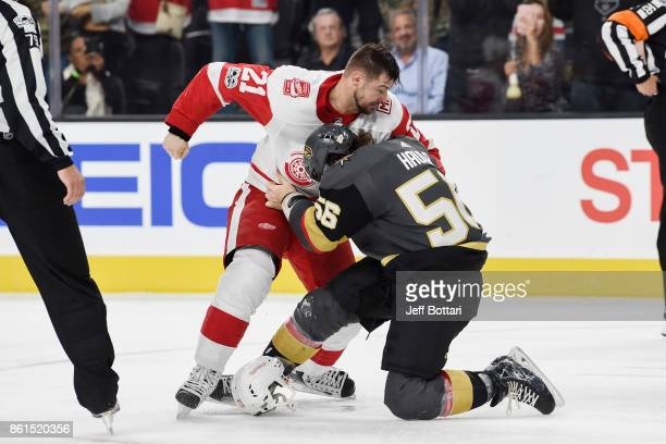 Erik Haula of the Vegas Golden Knights and Tomas Tatar of the Detroit Red Wings fight during the game at TMobile Arena on October 13 2017 in Las...