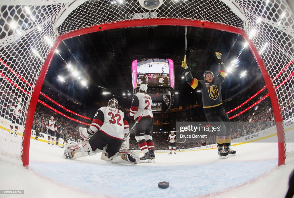 Erik Haula #56 of the Vegas Golden Knights celebrates a goal by Deryk Engelland #5 at 4:18 of the first period against Antti Raanta #32 of the Arizona Coyotes during the Golden Knights' inaugural regular-season home opener at T-Mobile Arena on October 10, 2017 in Las Vegas, Nevada. The Golden Knights defeated the Coyotes 5-2.