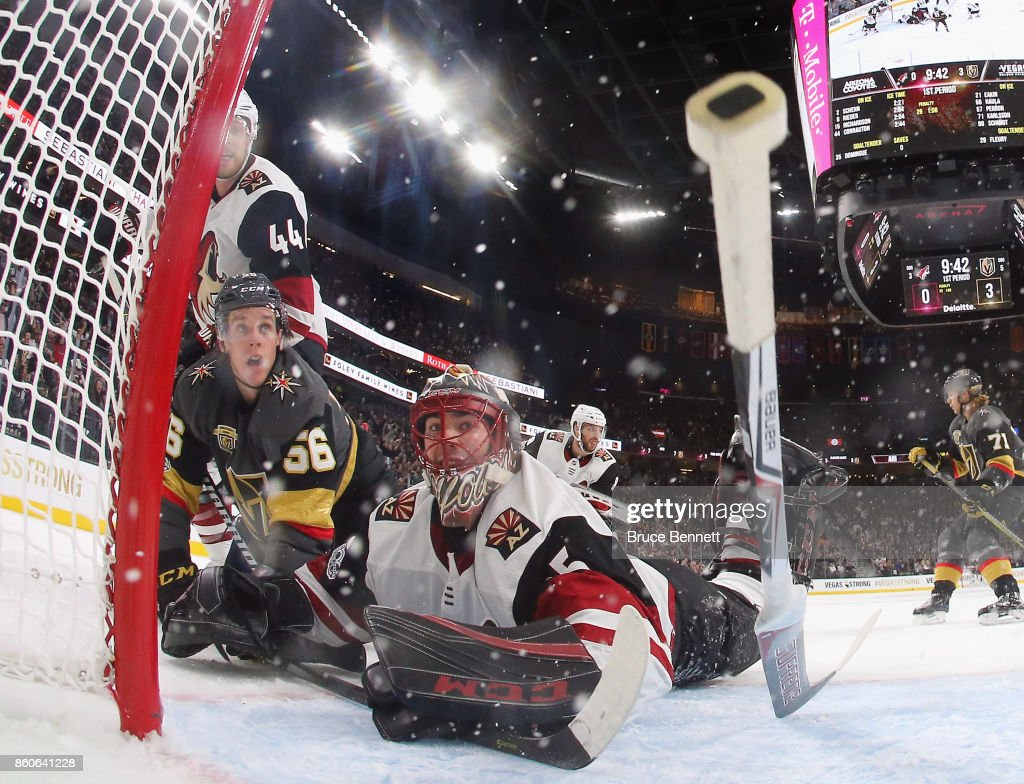Erik Haula #56 of the Vegas Golden Knights crashes into Louis Domingue #35 of the Arizona Coyotes during the Golden Knights' inaugural regular-season home opener at T-Mobile Arena on October 10, 2017 in Las Vegas, Nevada. The Golden Knights defeated the Coyotes 5-2.