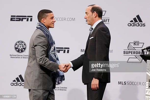 Erik Hurtado of Santa Clara shakes hands with commissioner Don Garber after being selected by Vancouver Whitecaps FC as the fifth overall pick in the...