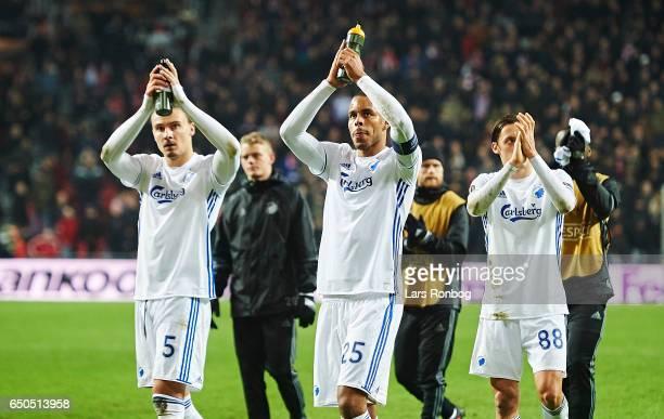 Erik Johansson Mathias Zanka Jorgensen and Uros Matic of FC Copenhagen celebrate after the UEFA Europa League Round of 16 First Leg match between FC...
