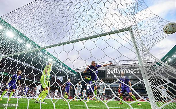 Erik Johansson of FC Copenhagen scores the 11 goal against Goalkeeper Johan Dahlin of FC Midtjylland and Andre Romer of FC Midtjylland during the...
