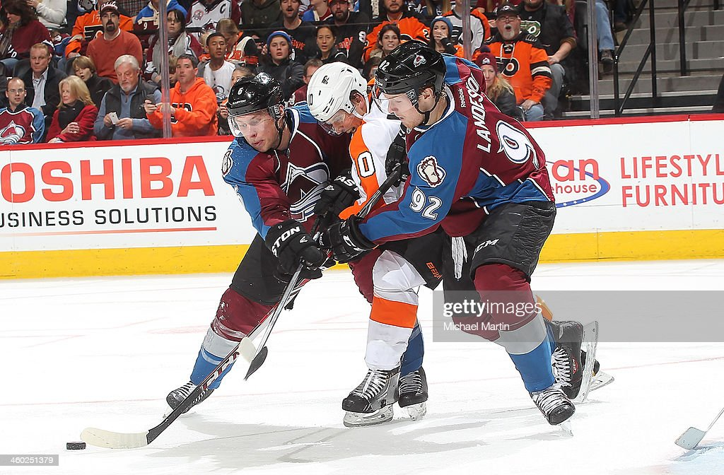 <a gi-track='captionPersonalityLinkClicked' href=/galleries/search?phrase=Erik+Johnson+-+Ice+Hockey+Player&family=editorial&specificpeople=457696 ng-click='$event.stopPropagation()'>Erik Johnson</a> #6 and <a gi-track='captionPersonalityLinkClicked' href=/galleries/search?phrase=Gabriel+Landeskog&family=editorial&specificpeople=6590816 ng-click='$event.stopPropagation()'>Gabriel Landeskog</a> #92 of the Colorado Avalanche converge on <a gi-track='captionPersonalityLinkClicked' href=/galleries/search?phrase=Brayden+Schenn&family=editorial&specificpeople=4782304 ng-click='$event.stopPropagation()'>Brayden Schenn</a> #10 of the Philadelphia Flyers at the Pepsi Center on January, 2014 in Denver, Colorado. The Avalanche defeated the Flyers 2-1.