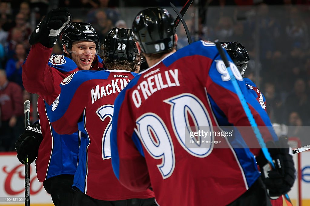 Erik Johnson #6 of the Colorado Avalanche celebrates his goal against the St. Louis Blues with teammates Nathan MacKinnon #29 and Ryan O'Reilly #90 to tie the score 2-2 in the second period at Pepsi Center on December 13, 2014 in Denver, Colorado.