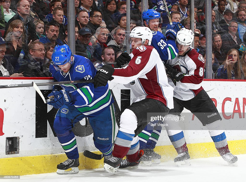 <a gi-track='captionPersonalityLinkClicked' href=/galleries/search?phrase=Erik+Johnson+-+Ice+Hockey+Player&family=editorial&specificpeople=457696 ng-click='$event.stopPropagation()'>Erik Johnson</a> #6 of the Colorado Avalanche checks <a gi-track='captionPersonalityLinkClicked' href=/galleries/search?phrase=Daniel+Sedin&family=editorial&specificpeople=202492 ng-click='$event.stopPropagation()'>Daniel Sedin</a> #22 of the Vancouver Canucks while <a gi-track='captionPersonalityLinkClicked' href=/galleries/search?phrase=Jan+Hejda&family=editorial&specificpeople=624333 ng-click='$event.stopPropagation()'>Jan Hejda</a> #8 of the Avalanche takes out <a gi-track='captionPersonalityLinkClicked' href=/galleries/search?phrase=Henrik+Sedin&family=editorial&specificpeople=202574 ng-click='$event.stopPropagation()'>Henrik Sedin</a> #33 of the Canucks during their NHL game at Rogers Arena April 10, 2014 in Vancouver, British Columbia, Canada. Colorado won 4-2.